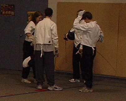 Fencers discussing how to conquer the world